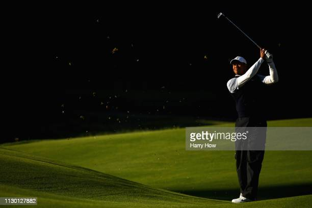 Tiger Woods hits a second shot on the 8th hole during the continuation of the second round of the Genesis Open at Riviera Country Club on February...
