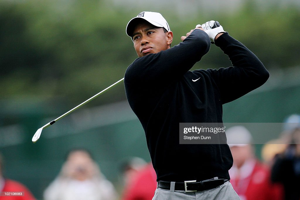 Tiger Woods hits a shot during a practice round prior to the start of the 110th U.S. Open at Pebble Beach Golf Links on June 15, 2010 in Pebble Beach, California.