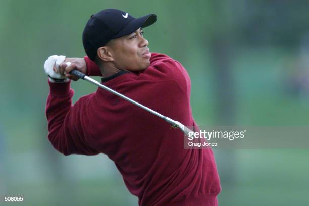 Tiger Woods hits a shot during the final round of the 2001 Bay Hill Invitational at the Bay Hill Club and Lodge in Orlando Florida DIGITAL IMAGE...