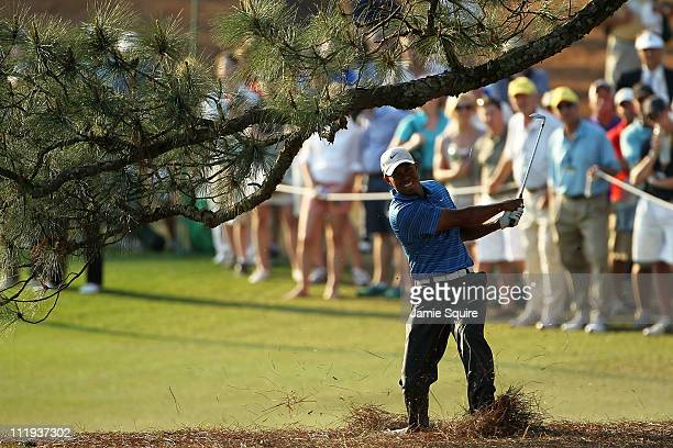 Tiger Woods hits a shot from the pine needles on the 17th hole during the third round of the 2011 Masters Tournament at Augusta National Golf Club on...
