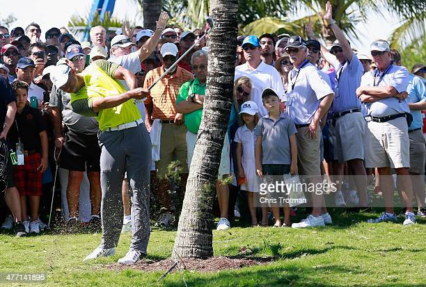 Tiger Woods hits a shot from the rough on the 18th hole during the second round of the World Golf ChampionshipsCadillac Championship at Trump...