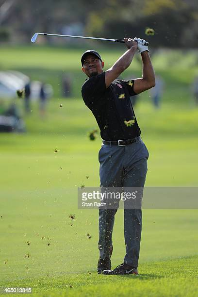 Tiger Woods hits a shot on the 14th fareway during the third round of the Farmers Insurance Open on Torrey Pines South on January 25, 2014 in La...