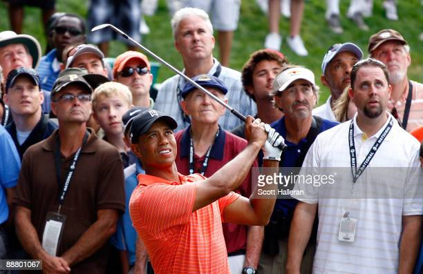 Tiger Woods hits a shot on the 16th hole during the first round of the ATT National at the Congressional Country Club on July 2 2009 in Bethesda...