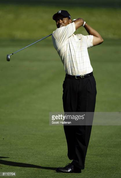Tiger Woods hits a shot on the fourth hole during the second round of the Bay Hill Invitational at the Bay Hill Club and Lodge on March 19, 2004 in...