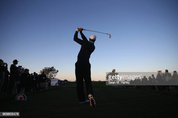 Tiger Woods hits a shot on the third hole during the pro-am round of the Farmers Insurance Open at Torrey Pines Golf Course on January 24, 2018 in...