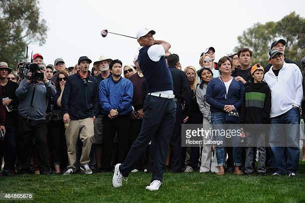Tiger Woods hits a shot on ther 9th hole during the second round of the Farmers Insurance Open on Torrey Pines North on January 24, 2014 in La Jolla,...