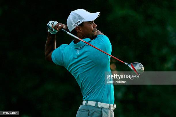 Tiger Woods hits a tee shot during a practice round prior to the start of the 93rd PGA Championship at the Atlanta Athletic Club on August 10 2011 in...