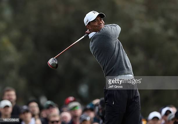 Tiger Woods hits a tee shot on the 12th hole during the third round of the Farmers Insurance Open at at Torrey Pines South Golf Course on January 27...