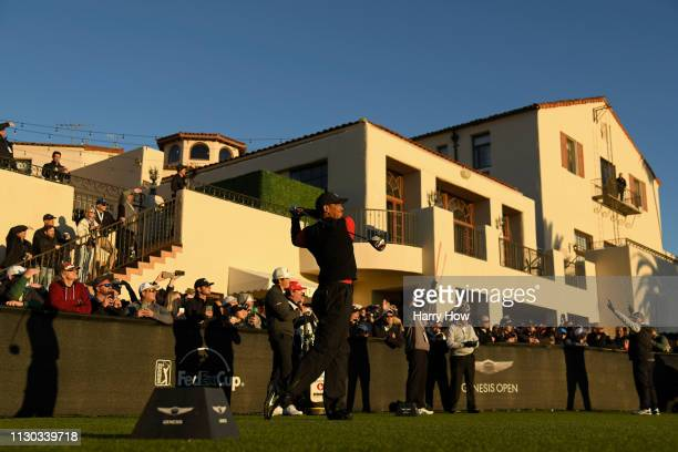 Tiger Woods hits a tee shot on the 1st hole during the continuation of the third round of the Genesis Open at Riviera Country Club on February 17,...