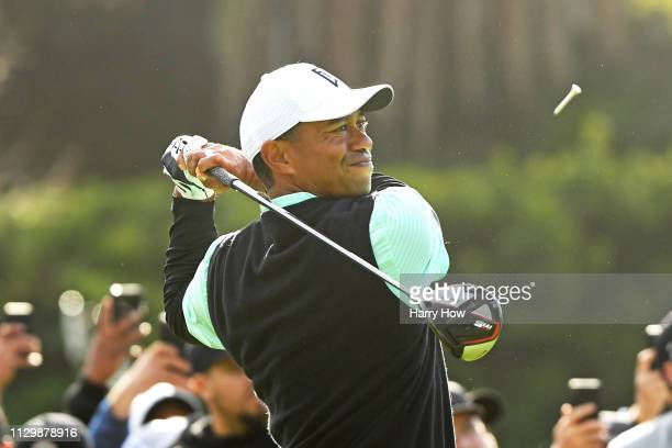 Tiger Woods hits a tee shot on the 2nd hole during the continuation of the first round of the Genesis Open at Riviera Country Club on February 15...