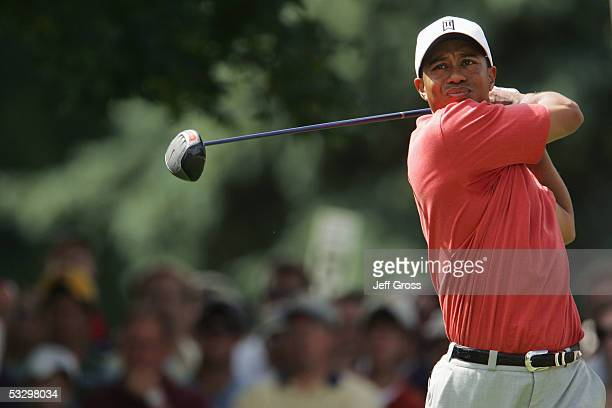 Tiger Woods hits a tee shot on the seventh hole during the first round of the Buick Open July 28 2005 at the Warwick Hills Golf Country Club in Grand...