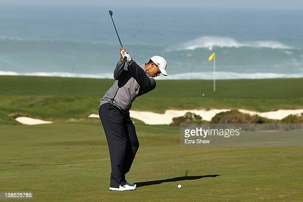 Tiger Woods hits an approach shot during a practice round for the ATT Pebble Beach National ProAm at the Monterey Peninsula Country Club on February...