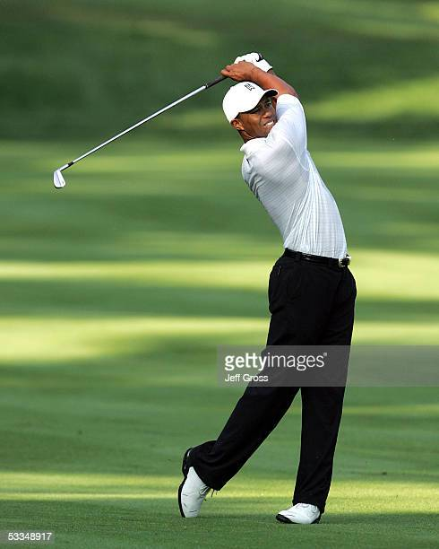 Tiger Woods hits an approach shot during the third practice round of the 2005 PGA Championship at Baltusrol Golf Club on August 10, 2005 in...