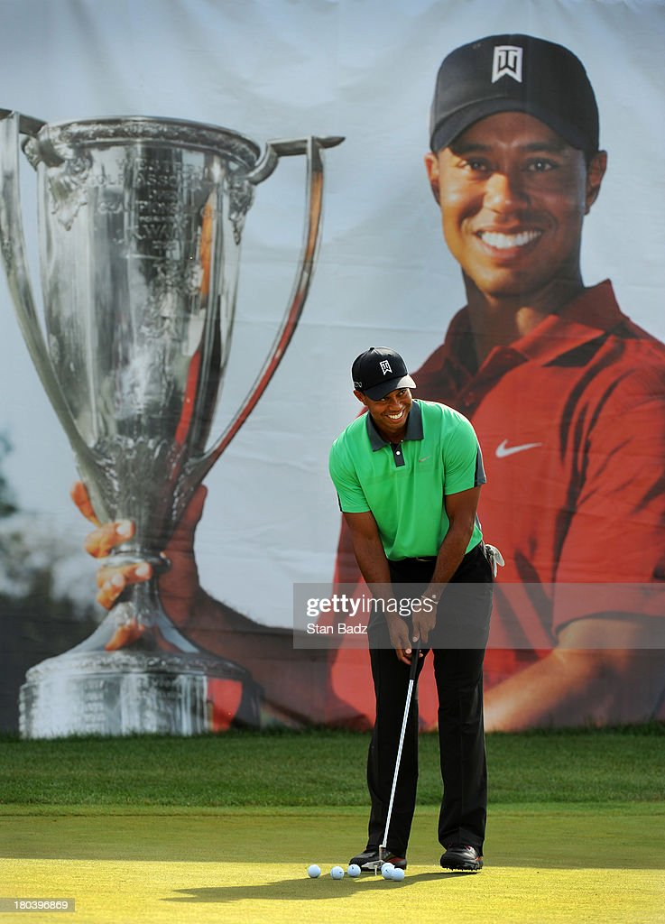 Tiger Woods hits ball on the practice putting green before the first round of the BMW Championship at Conway Farms Golf Club on September 12, 2013 in Lake Forest, Illinois.