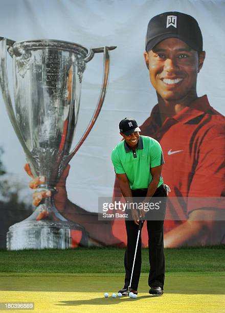 Tiger Woods hits ball on the practice putting green before the first round of the BMW Championship at Conway Farms Golf Club on September 12, 2013 in...