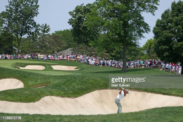 Tiger Woods hits from a bunker on the 10th hole during the third round of The Memorial Tournament Presented by Nationwide at Muirfield Village Golf...