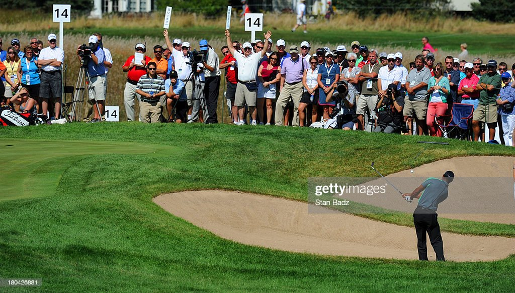 Tiger Woods hits from a bunker on the 13th hole during the first round of the BMW Championship at Conway Farms Golf Club on September 12, 2013 in Lake Forest, Illinois.