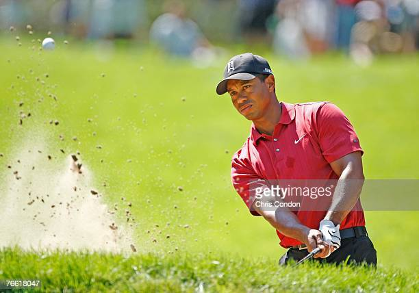 Tiger Woods hits from a bunker on the second hole during the final round of BMW Championship, the third event of the new PGA TOUR Playoffs for the...