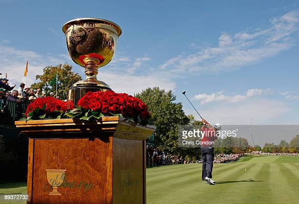 Tiger Woods hits from the first tee during the fifth round of singles competition for The Presidents Cup on September 30 at The Royal Montreal Golf...