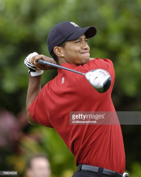Tiger Woods hits from the first tee during the rain-delayed final round of the Mercedes Championships, January 9, 2005 at The Plantation Course,...
