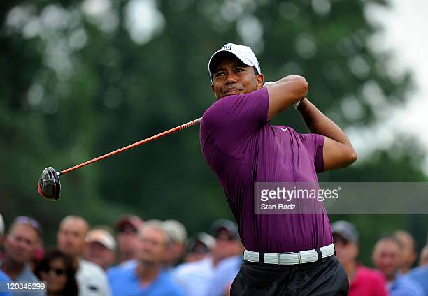 Tiger Woods hits from the ninth hole during the first round of the World Golf Championships-Bridgestone Invitational at Firestone Country Club on...