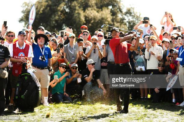 Tiger Woods hits from the rough of the 4th hole on the South Course during the final round of the Farmers Insurance Open golf tournament at Torrey...