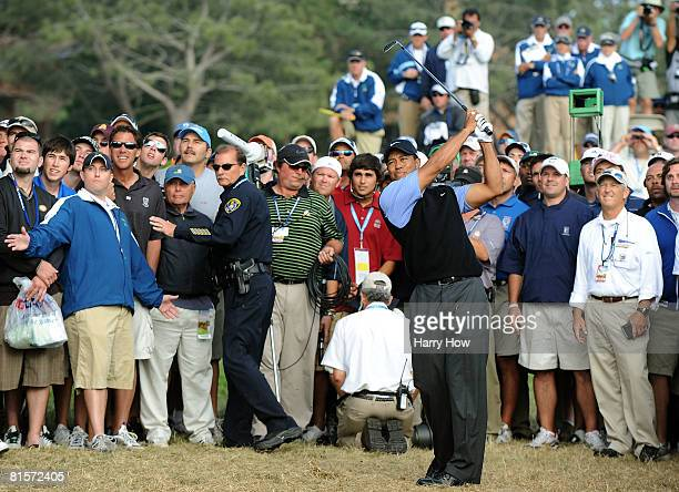 Tiger Woods hits from the rough on the 17th hole during the third round of the 108th US Open at the Torrey Pines Golf Course on June 14 2008 in San...
