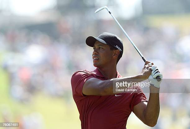 Tiger Woods hits his approach shot on the tenth hole during the final round of the 89th PGA Championship at the Southern Hills Country Club on August...