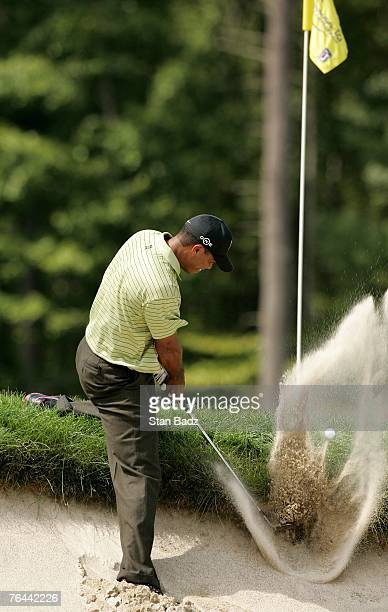 Tiger Woods hits his ball out of the bunker at the fourth hole during the first round of the Deutsche Bank Championship at TPC Boston on August 31,...
