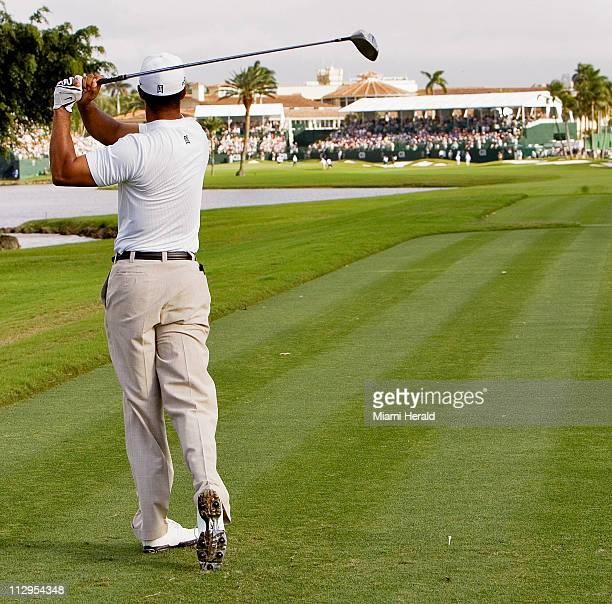 Tiger Woods hits his drive on the 18th hole during the third round of CA Championship golf tournament in Doral Florida Saturday March 24 2007