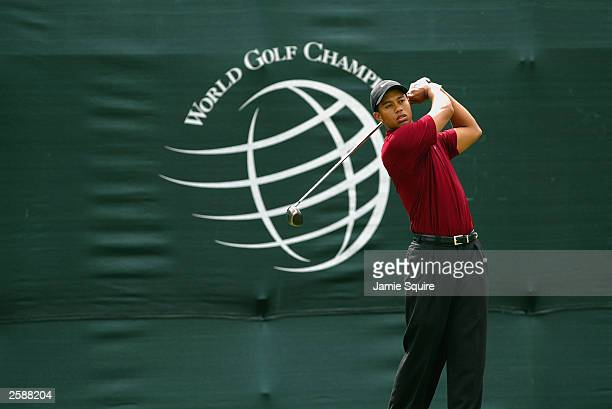 Tiger Woods hits his first shot on the 1st hole during the final round of the World Golf ChampionshipsAmerican Express Championship on October 5 2003...