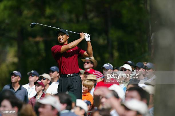 Tiger Woods hits his first shot on the 4th hole during the final round of the World Golf ChampionshipsAmerican Express Championship on October 5 2003...