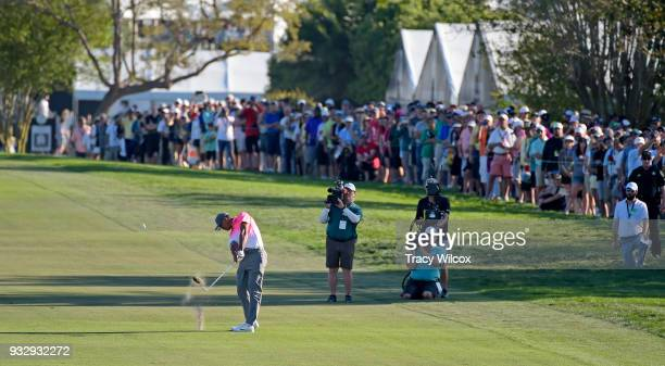 Tiger Woods hits his second shot at hole No 18 during the second round of the Arnold Palmer Invitational presented by MasterCard at Bay Hill Club and...