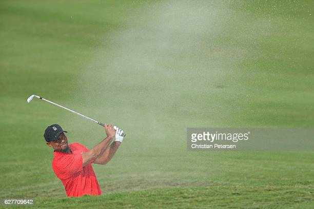 Tiger Woods hits his second shot from a bunker on the 11th hole during the final round of the Hero World Challenge at Albany The Bahamas on December...