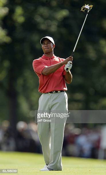 Tiger Woods hits his second shot from the 18th fairway during the first round of the Buick Open July 28 2005 at the Warwick Hills Golf Country Club...