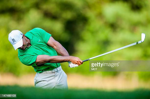 Tiger Woods hits his second shot from the fairway on the 14th hole during the third round of the ATT National golf tournament at Congressional...