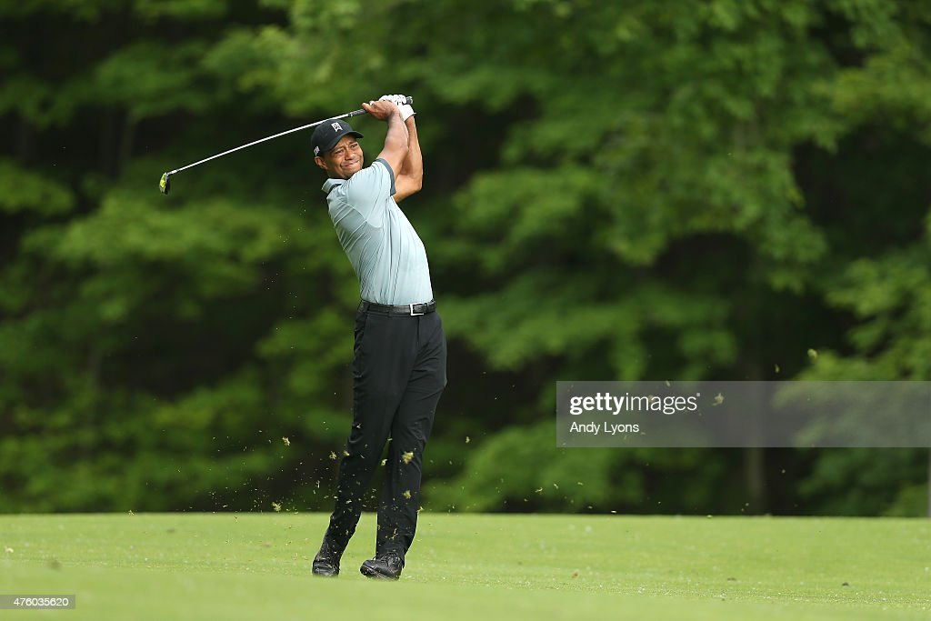 Tiger Woods hits his second shot on the 15th hole during the second round of The Memorial Tournament presented by Nationwide at Muirfield Village Golf Club on June 5, 2015 in Dublin, Ohio.