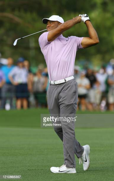 Tiger Woods hits his second shot on the 15th hole during the third round of the Masters Tournament on April 13 in Augusta Georgia