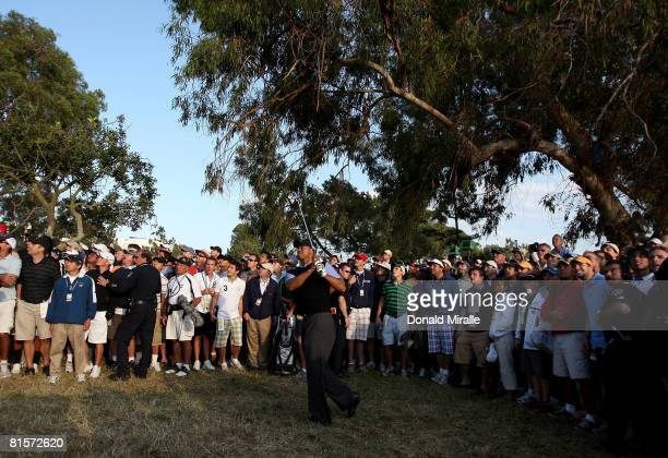 Tiger Woods hits his second shot on the 17th hole during the third round of the 108th US Open at the Torrey Pines Golf Course on June 14 2008 in San...