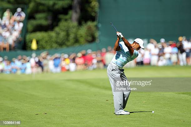 Tiger Woods hits his second shot on the 18th hole during the second round of The Barclays at the Ridgewood Country Club on August 27 2010 in Paramus...