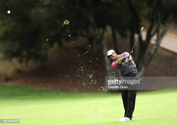 Tiger Woods hits his second shot on the 18th hole during the second round of the Tiger Woods World Challenge Presented by Northwestern Mutual at...