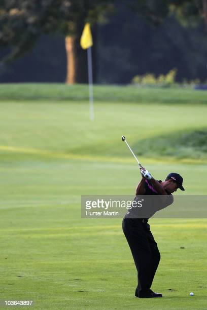 Tiger Woods hits his second shot on the first hole during the first round of The Barclays at the Ridgewood Country Club on August 26 2010 in Paramus...