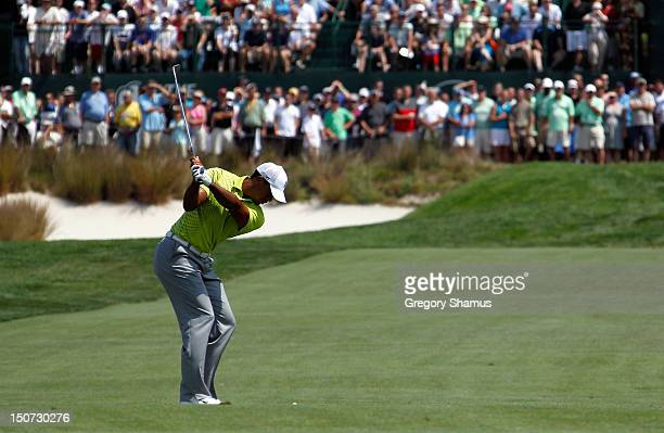 Tiger Woods hits his second shot on the first hole during the third round of The Barclays at the Black Course at Bethpage State Park August 25 2012...