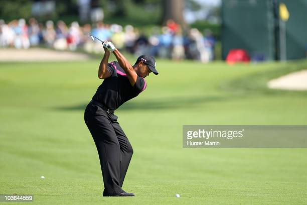Tiger Woods hits his second shot on the ninth hole during the first round of The Barclays at the Ridgewood Country Club on August 26 2010 in Paramus...