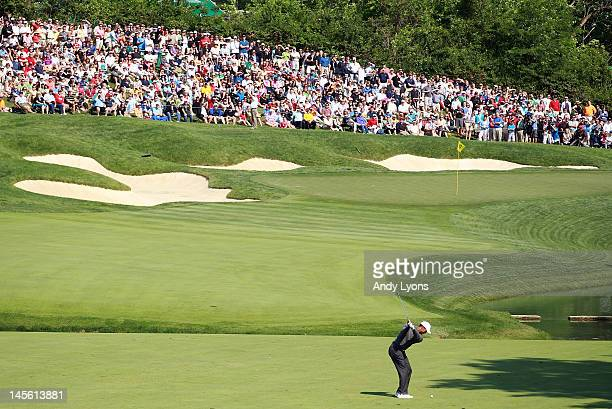 Tiger Woods hits his second shot on the par 4 14th hole during the third round of the Memorial Tournament presented by Nationwide Insurance at...
