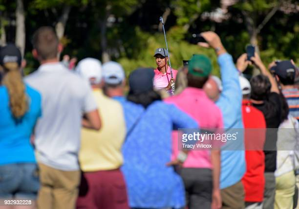 Tiger Woods hits his tee shot at hole No 14 during the second round of the Arnold Palmer Invitational presented by MasterCard at Bay Hill Club and...