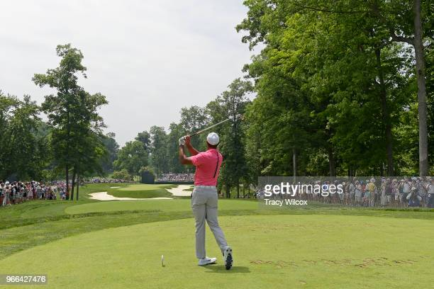 Tiger Woods hits his tee shot at the eight hole during the third round of the Memorial Tournament presented by Nationwide at Muirfield Village Golf...