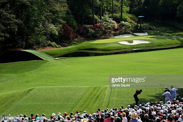 Tiger Woods hits his tee shot on the 12th hole during the final round of the 2011 Masters Tournament at Augusta National Golf Club on April 10 2011...