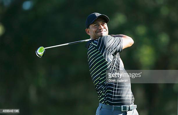 Tiger Woods hits his tee shot on the 12th hole during the first round of the Hero World Challenge at the Isleworth Golf Country Club on December 4...