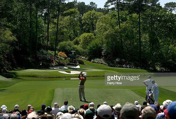 Tiger Woods hits his tee shot on the 12th hole during the second round of The Masters at the Augusta National Golf Club on April 6, 2007 in Augusta,...